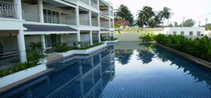 Pool front Condo for sale in Cape Panwa. Offering Apartments for sale and re-sale in a secure community on Phuket for expats, retirees and families. - 1